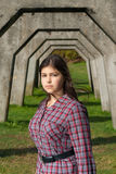 Young girl in concrete arches Royalty Free Stock Photo