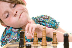 Young girl considering chess move Royalty Free Stock Photo
