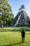 Young Girl Contemplating Mayan Ruins at Tikal, National Park. Tr Stock Photos