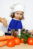 Young Girl in Cook's Cap Preparing Food Royalty Free Stock Photo