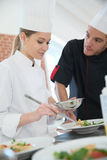 Young girl cooking with chef Royalty Free Stock Photography