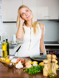 Young girl cooking first dish Royalty Free Stock Photo
