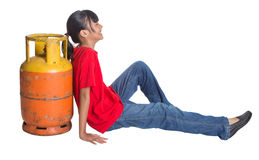 Young Girl And Cooking Gas Cylinder II Stock Photos