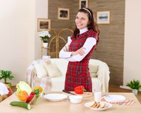 A young girl cooking at home Royalty Free Stock Images