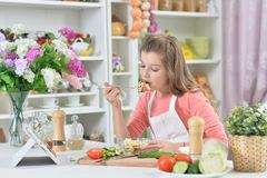 Young girl cooking in kitchen at home stock image