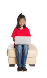Young Girl On The Couch With Laptop IV Stock Photography