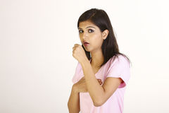 Young girl coughing Royalty Free Stock Image