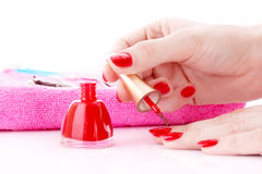 Young girl cover her nails with varnish Stock Photos