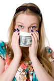 A young girl covers her face with a pack of dollars Royalty Free Stock Photography