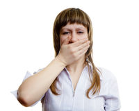 Young girl covers her mouth with his hands. On a white background Stock Photography