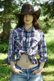 Young girl in  cowboy hat Stock Images