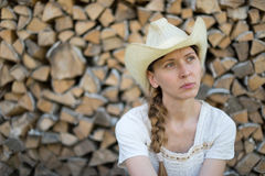 Young girl in a cowboy hat on  background of wood Royalty Free Stock Photos