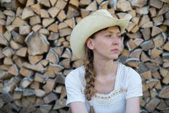 Young girl in a cowboy hat on  background of wood Stock Images