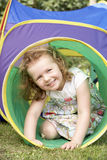 Young Girl Crawling Through Play Equipment Royalty Free Stock Photos