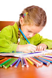 Young girl and crayons. Sitting young girl with crayons Royalty Free Stock Image