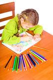 Young girl with crayons. Sitting young girl with crayons Royalty Free Stock Photos