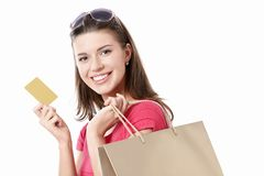 Young girl with a credit card Royalty Free Stock Photos