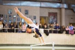 Young girl on the crossbar perform in Hall Dynamo Stadium Stock Images