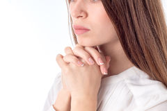 Young girl crossed her fingers and palms near face close-up Stock Images