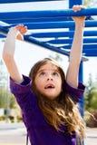 Young Girl Crossing Monkey Bars Stock Photos