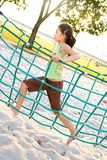 Young girl crossing the rope bridge Royalty Free Stock Photo