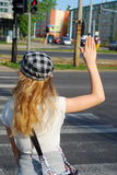 Young girl crossing the street. Alone with hand up Stock Photo