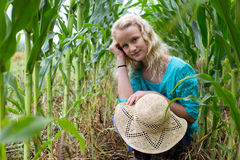 Young girl crouched corn field Royalty Free Stock Images