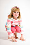 Young girl crouching Royalty Free Stock Photo