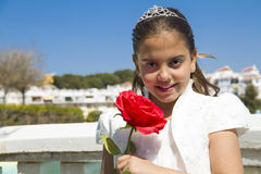 Young girl with crown and a red rose Royalty Free Stock Photography