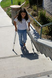Young Girl with Crutches at Steps Royalty Free Stock Photos