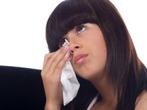 Young girl crying. A sad young girl crying holding a handkerchief Stock Photography