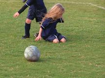 Young girl crying over soccer loss. A young girls sits down and cries over losing the soccer game Royalty Free Stock Photo