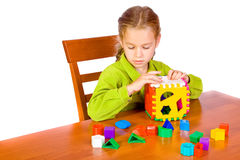 Young girl with cube. Sitting young girl with cube Royalty Free Stock Images