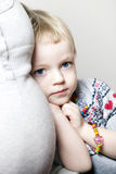 Young girl cuddled up to her mother Stock Images