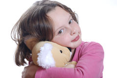 Young girl cuddling teddy bear Royalty Free Stock Photos