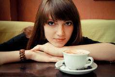 Young girl with a cup of coffee Stock Image