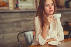 Young girl with a cup of coffee Royalty Free Stock Image