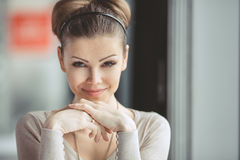 Young girl with a cup of coffee. Focus on the eyes. Pretty young woman sitting in a cafe with a cup of coffee latte stock images