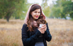 Young girl with a cup of coffee Royalty Free Stock Photography