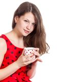 Young girl with a cup of tea in her hands Stock Photo