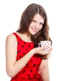Young girl with a cup of tea in her hands Stock Images