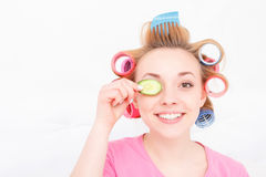 Young girl with curlers on her hair Royalty Free Stock Photos