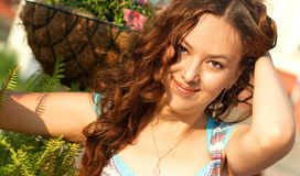 Young girl with curly hair. Young beautiful girl with curly hair on open-air Royalty Free Stock Image