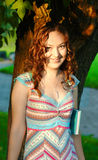 Young girl with curly hair. Smile Royalty Free Stock Photos