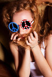 Young girl with curly hair wearing sunglasses with the American Stock Photo