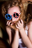 Young girl with curly hair wearing sunglasses with the American Royalty Free Stock Images