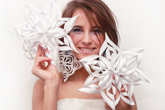 Young girl with cut snowflakes Royalty Free Stock Image