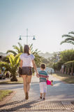 Young girl and cute kid with a skateboards outdoor Royalty Free Stock Photos
