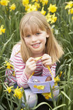 Young Girl In Daffodils At Easter Stock Photography