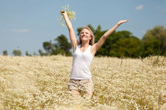 Young girl with daisies Stock Images